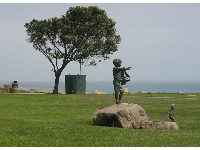 Sailor boy statue at the grassy lawn above the two coves.