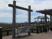 Bench swing and gazebo on the boardwalk.
