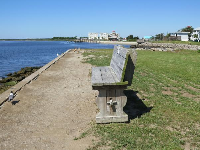 Bench by the water along West Bay Street.