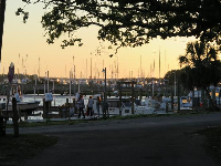Sunset on Brunswich Street, with boats at Southport Marina in the distance.