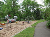 Greenway alongside the playground, where little ones can ride their tricycle.