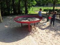 Boys playing in the sand pit.