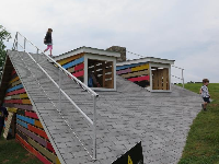 Climbing on the roof of the house installation.