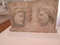 Roman relief with theater masks.