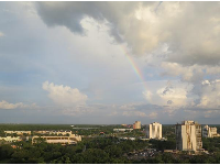 View of a rainbow from a city-view room.
