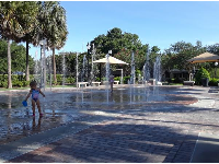 A girl plays at the splash pad.