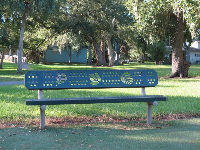 Cute park bench with leaf cutouts.