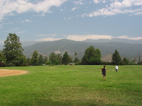 Mountain panorama and a sports field to play ball on.
