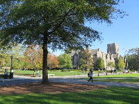 A student walking on campus in November.