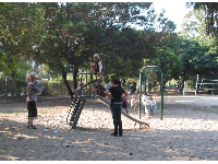 The small playground on the northern end of the park, by the soccer field.