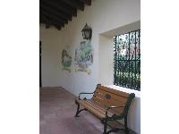 The California mission courtyard walls with murals.