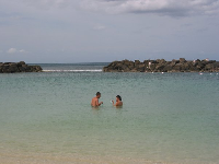 A couple having a great swim at Ko Olina Beach.