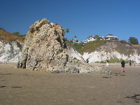 Sea stack and Cal Poly students.