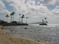 The little island of Kahala Resort, as seen from Waialae Beach Park.