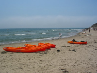 Kayaks on the sand at Campus Point.