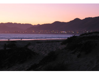 The dunes and city lights, sunset at Pismo State Beach.