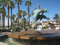 The famous dolphin fountain at the base of the pier.