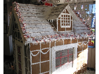 Gingerbread House at Olsen's Bakery in December. Taller than a person!