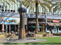 Whimsical fountain outside Starbucks. Grab a coffee and sit in the sun!