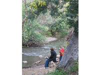 A mother and son enjoy peaceful Los Gatos Creek.