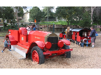 Old fire engine and train at Oak Meadow Park.