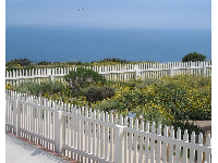 White picket fence and dreamy views, at the lighthouse.