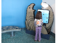 A girl explores the sounds that elephant seals make.