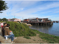 A couple sit and enjoy the tranquility at Monterey Harbor.