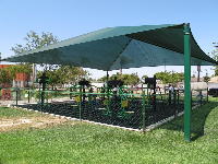 The workout playground under a green canopy.