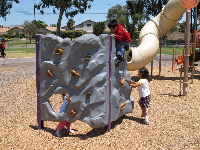Rock climbing at the playground.
