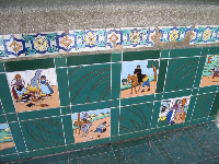 Medieval tiles on benches around the fountain.