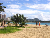 Joggers on Ala Moana Beach.