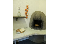 Bake bread inside the Portuguese seaside house.