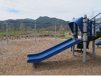 Kids LOVE roller slides! Swings with mountain views.