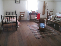 The bedroom in the commanding officer's quarters.