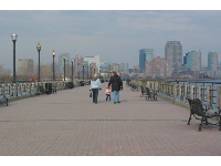 Taking a winter stroll along the boardwalk with views of Jersey city skyline.