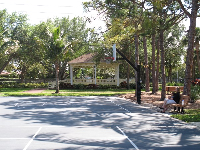Basketball courts with shaded bench and gazebo.