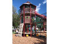 Rock-climbing wall, bridge, and fort at the big kids' playground.
