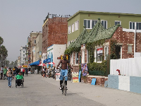People enjoying a stroll or bike ride along Ocean Front Walk. Notice the cute architecture.