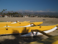 Canoes at the harbor end of West Beach.