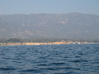 Red cliffs of East Beach, as seen by boat.