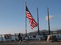 Navy sailor guards USS Milius, which visited Santa Barbara Harbor in November 2011.