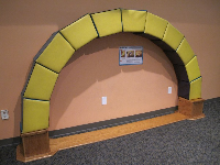 Teamwork is required to make this Roman arch out of huge soft vinyl blocks.