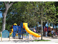 Playground with trees for some shade.