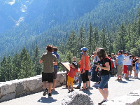 Visitors enjoy the view at Tunnel View Lookout. Look at all those wonderful trees!