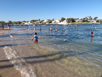 A boy plays in the water at the inlet side of Dubois Park.