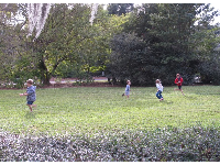 Kids running on the lawn.