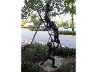 Sculpture of children climbing a ladder.