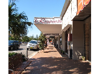 Shops along the main road by the beach.