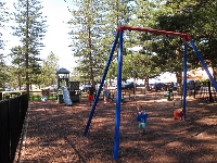 Families enjoying the large playground by the beach.